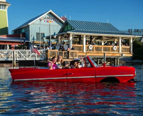 Saratoga Spring Resort | People riding an Amphicar At the Lake